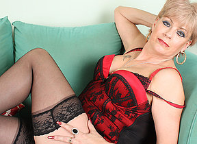 British MILF pleases herself primarily couch