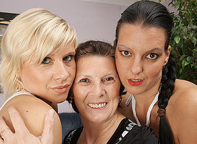 Three naughty old and young lesbians do it above the couch