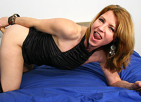 This horny MILF loves to get wet on the top of her bed