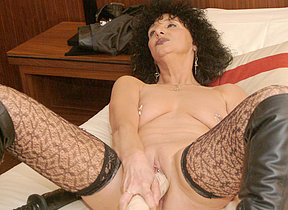 Kinky mature battleaxe pumping herself in the matter of huge toys