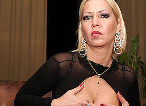 Horny MILF carryingon with herself