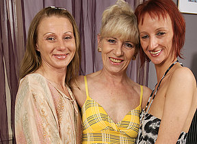 Several mature lesbians party on the sofa