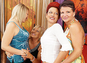 Three old and young lesbians having a pack on bed