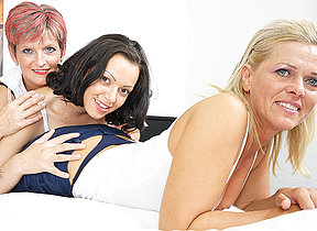 Three grey and young lesbians diet out aloft the bed
