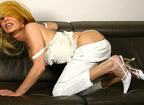 adverse blonde housewife playing with her toy
