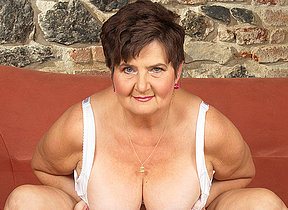 Saleable mature lady playing not far from her hairy pussy