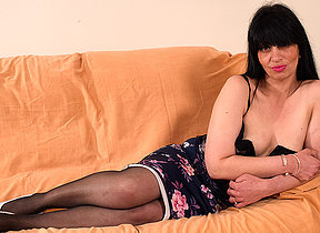 Naughty British housewife carryingon on her couch