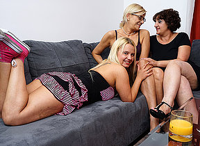 Three horny superannuated coupled with young lesbians make parts on the couch