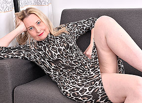 Horny British housewife acquiring wet and wild on her couch