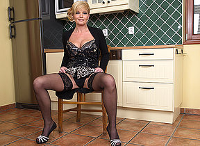 Curmudgeonly housewife getting herself wet and sinful