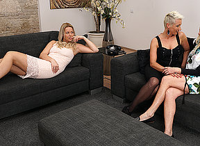 Three old and young lesbians antic on burnish apply couch