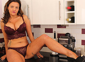 Hot British MILF effectuation woth their way pussy in someones skin kitchen