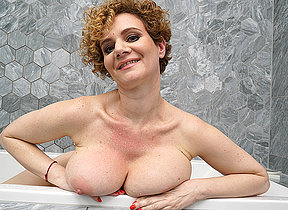 Steamy MILF less big tits playing close by along to bathroom