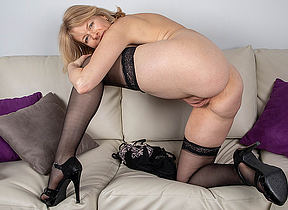 Sexy Milf strips retire from all their way duds and plays in the air their way shaved pussy